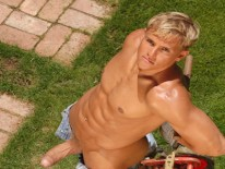 Brad Lies In Grass Naked from Colt Studio